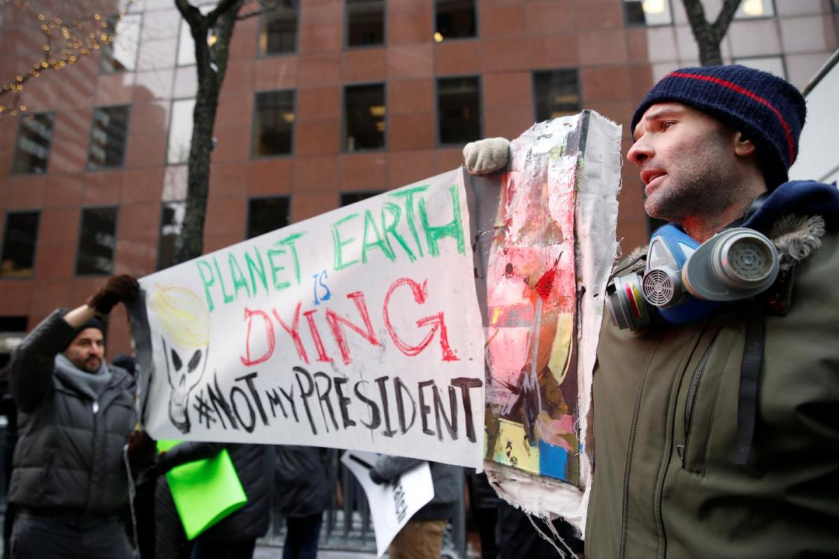 Demonstrators protest Donald Trump's climate change stance outside the office of U.S. Senator Charles Schumer (D-NY) in New York, January 9. REUTERS.