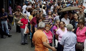 People queueing to buy food are prey for thieves in Caracas, capital of Venezuela. Photograph: Carlos Garcia Rawlins/Reuters
