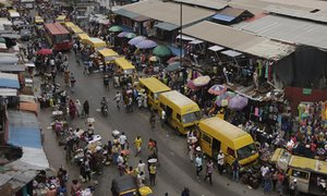 People shopping at a market in Lagos, Nigeria. Photograph: Sunday Alamba/AP