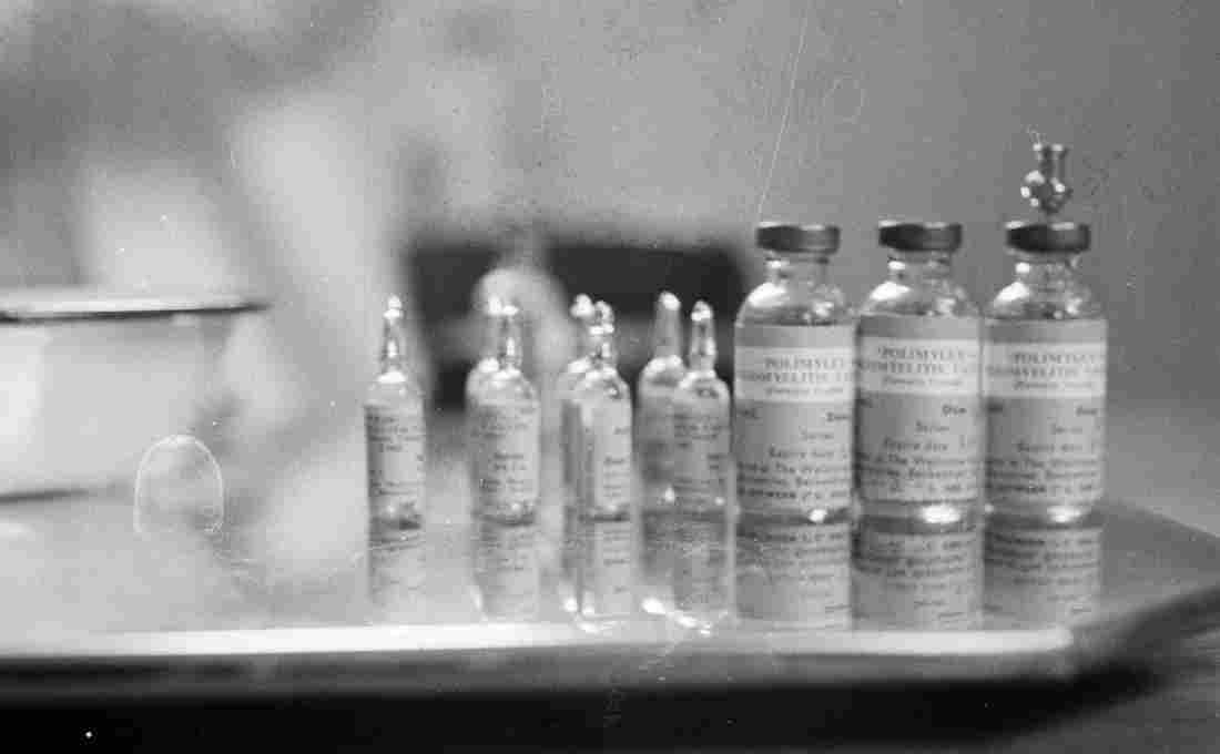 April 1959: Bottles containing the polio vaccine. M. McKeown/Getty Images