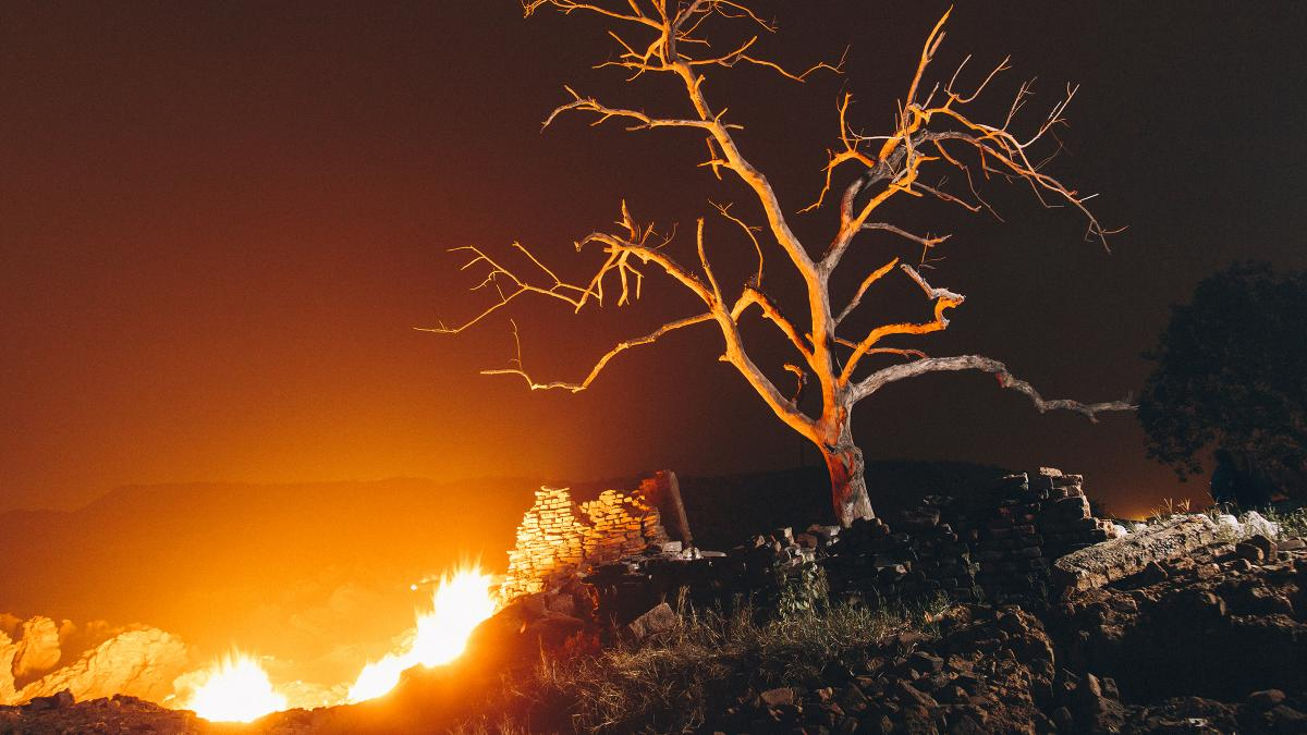 Flames rise from the ground in Jharia coalfield, where the land around the areas has burned for a century as a result of mining and venting gases.