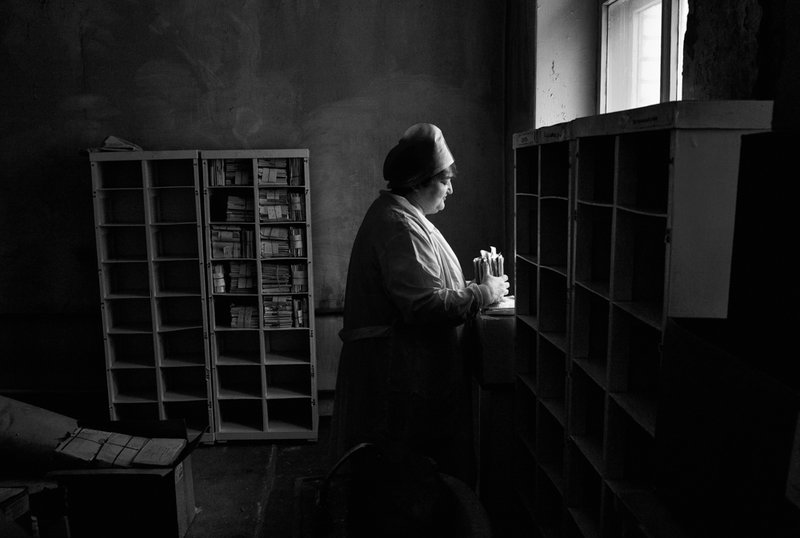 A nurse organizes the files of deceased patients at a TB hospital in Togliatti, Russia. Multi-drug-resistant tuberculosis is a huge problem in the former Soviet Union. Misha Friedman