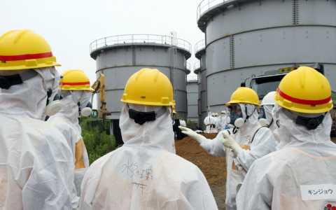 Workers at leaking water tanks at the Fukushima nuclear plant. Japan Pool/ AFP/ Getty Images