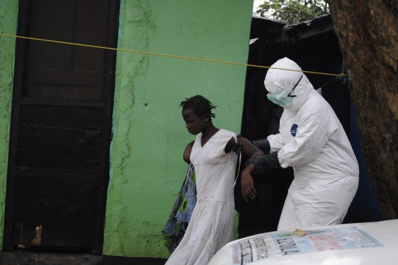 A health worker brings a woman suspected of having contracted the Ebola virus to an ambulance in Monrovia, Liberia, September 15, 2014. Airlines have halted many flights into and around West Africa, where governments have closed some borders and imposed travel restrictions in a bid to fight an Ebola outbreak that has killed over 2,400 people. (Stringer/Reuters)