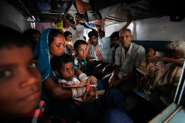 New Delhi train passengers sit stranded in a darkened train idled by the massive power outage that swept across India on Tuesday.